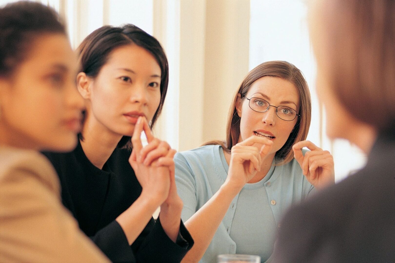 A group of women deep in discussion