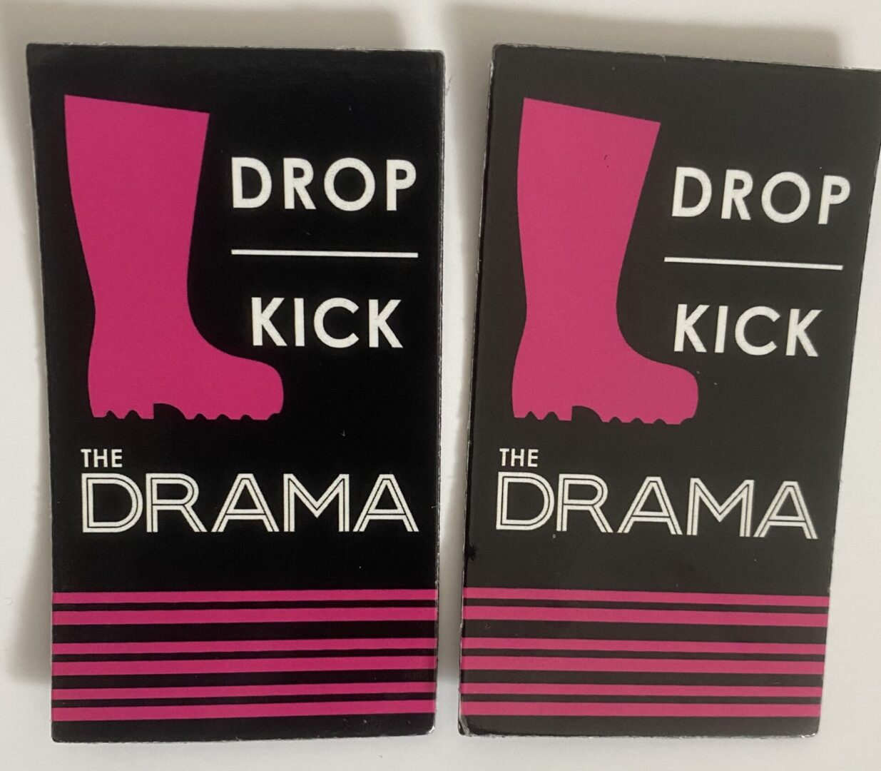 A picture of two DKTD Badges